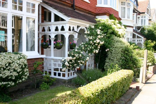front porch with hanging baskets