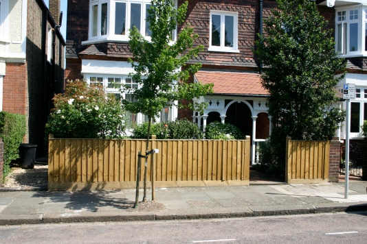 Stained wooden fences practical but strike a sometimes incongruous rural note