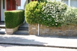 This low wall and flowering shrubs strikes the right note