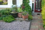 This informal group of planters adds a living green touch at little cost